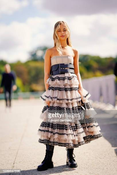 Amelia Windsor wears a ruffled lace dress outside Dior during Paris Fashion Week Womenswear Spring/Summer 2019 on September 24 2018 in Paris France