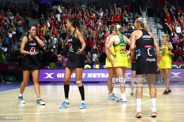 Ameliaranne Ekenasio Maria Folau and Laura Landman of New Zealand celebrate after winning The Final of The Vitality Netball World Cup between New...