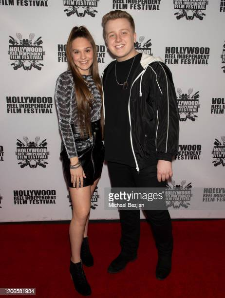 Amelie Anstett and Cameron McLeod arrive at A Dark Foe Film Premiere on February 15 2020 in Los Angeles California
