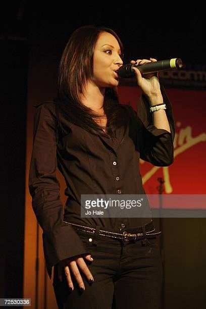 Amelie Berrabah of the Sugababes performs at the Virgin Megastore on Oxford Street for the launch of their new album 'Overloaded The Singles...