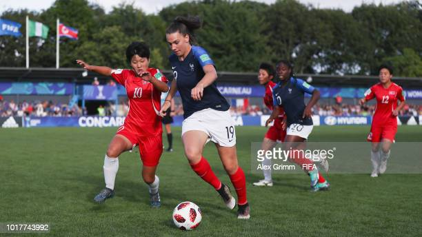 Amelie Delabre of France is challenged by Kim Kyong Yong of Korea DPR during the FIFA U20 Women's World Cup France 2018 Quarter Final quarter final...