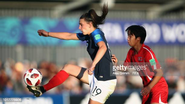 Amelie Delabre of France is challenged by Ri Kum Hyang of Korea DPR during the FIFA U20 Women's World Cup France 2018 Quarter Final quarter final...