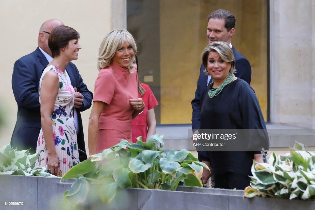Amelie Derbaudrenghien, partner of Belgian prime minister, Brigitte Macron, wife of the French president, Maria Teresa, Grand Duchess of Luxembourg, and Gauthier Destenay, husband of Luxembourg's prime minister, walk in Luxembourg on August 29, 2017. French President Emmanuel Macron is on a visit to Luxembourg. /