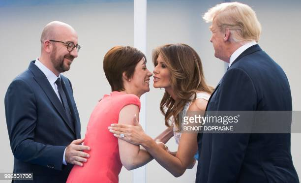 Amelie Derbaudrenghien partner of Belgian Prime Minister Charles Michel kisses Melania Trump the wife of US President Donald Trump upon their arrival...