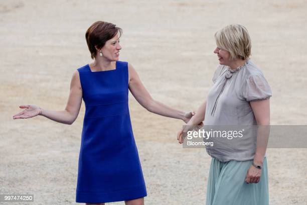 Amelie Derbaudrenghien partner of Belgiums Prime Minister Charles Michel left welcomes Karin Ratas wife of Estonias Prime Minister Juri Ratas as...