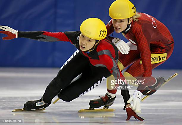 Amelie GouletNadon of Canada pushes Wei Wang of China in the final lap in the women's 3000m relay finals at the ISU World CUP Short Track Speed...