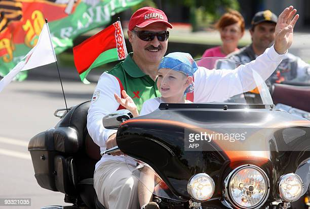 Amelie HERENSTEIN Picture taken on July 18, 2009 shows Belarussian President Alexander Lukashenko riding a Harley-Davidson motorcycle with his son...