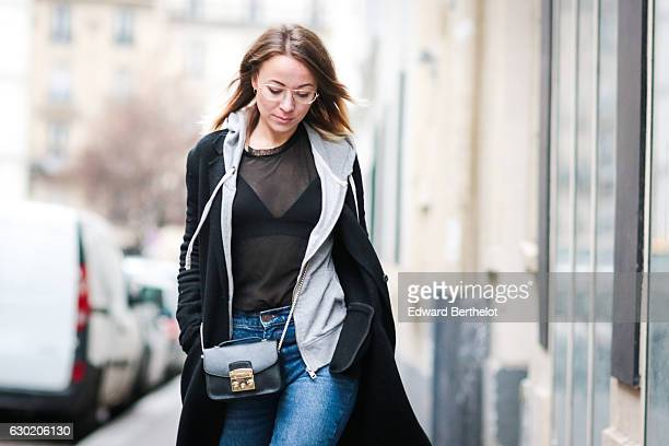 Amelie Lloyd fashion and life style blogger wears Sandro blue denim jeans Vans shoes HM fishnet socks black bras a Zara mesh top and a Zara long coat...