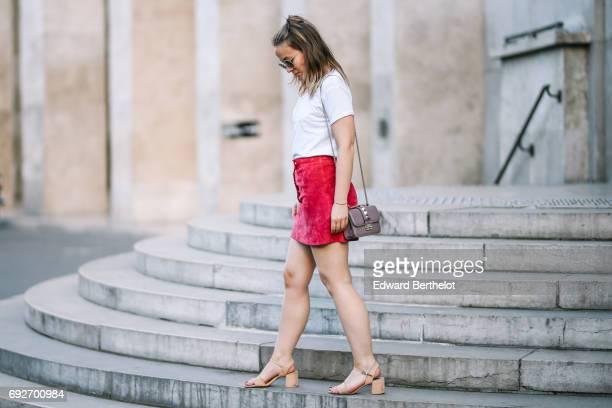 Amelie Lloyd fashion blogger wears a Courreges pink red velvet skirt a Maison Scotch white top a Valentino Rockstud bag and Zara sandals at Palais de...