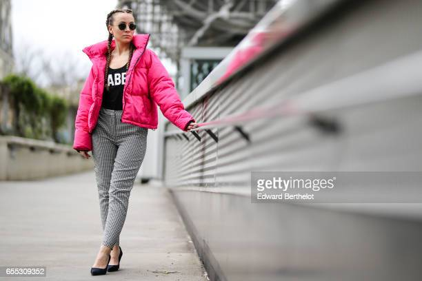 Amelie lloyd fashion blogger wears a New Look pink puffer coat New Look black and white pants sunglasses and a Jennyfer black sleeveless top with the...