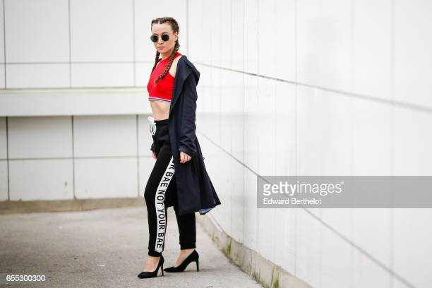 Amelie Lloyd fashion blogger wears Jennyfer pants with the printed inscription 'Not Your BAE' a Jennyfer red sleeveless bare belly shirt sunglasses a...