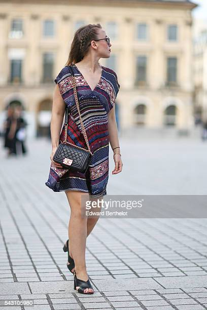 Amelie Lloyd is wearing a Kenzo dress, Dior sunglasses, a Chanel bag, and Minelli shoes, after the Henrik Vibskov show, during Paris Fashion Week...