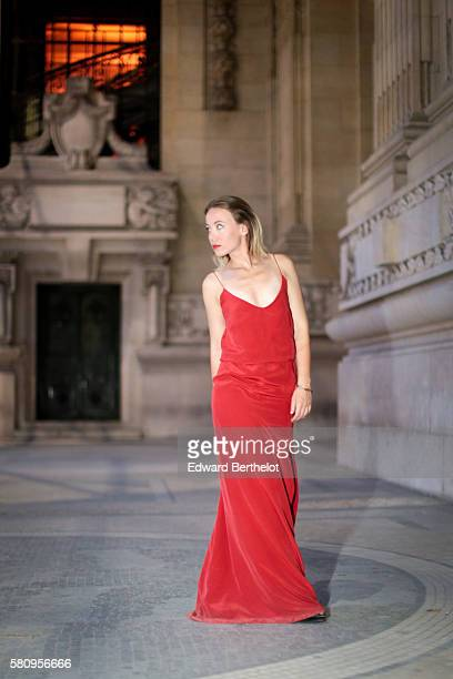 Amelie Lloyd , is wearing a Maison Lemoine red dress, and Balmain shoes, during a street style session, at the Grand Palais, on July 25, 2016 in...
