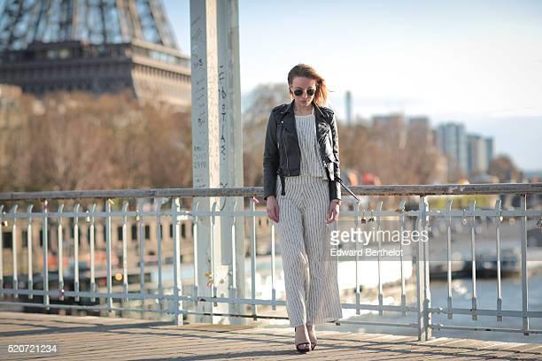 Amelie Lloyd is wearing a Zara black leather jacket a Zara white striped top Zara white striped pants Zara black heels Rayban sunglasses and a Nixon...
