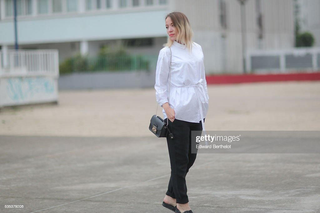 b8aa32d8711f Amelie Lloyd is wearing And Other Stories black pants, a Cos white ...