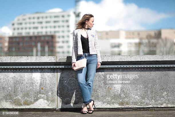 Amelie Lloyd is wearing HM blue jeans Zara black shoes a Sandro black top and a Sandro jacket during a street style session on April 6 2016 in Paris...