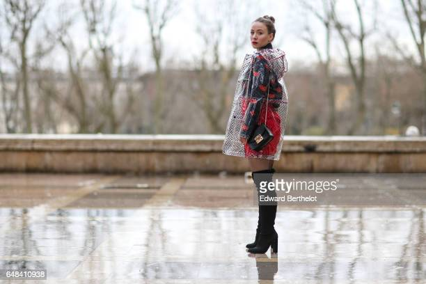 Amelie Lloyd wears Newlook black thigh high boots a Newlook red skirt a Victoria Beckham shirt a Newlook raincoat and a Furla bag outside the Mashama...