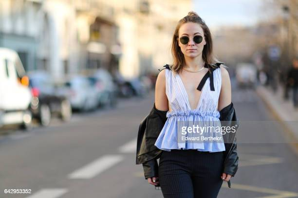 Amelie Lloyd wears Zara pants a Zara off shoulder and low neck blue top Zara black shoes sunglasses a Valentino Rockstud bag and a black perfecto...