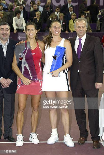Amelie Mauresmo and Mary Pierce stand with trophies. Amelie Mauresmo defeated French compatriot Mary Pierce 6-1, 7-6 to win the Gaz de France on...
