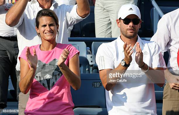 Amelie Mauresmo coach of Andy Murray of Great Britain and hitting partner Daniel Vallverdu attend Andy's match on Day 8 of the 2014 US Open at USTA...