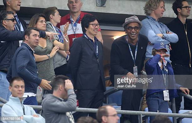 Amelie Mauresmo JeanVincent Place Yannick Noah and his son Joalukas Noah attend the UEFA Euro 2016 quarter final match between France and Iceland at...