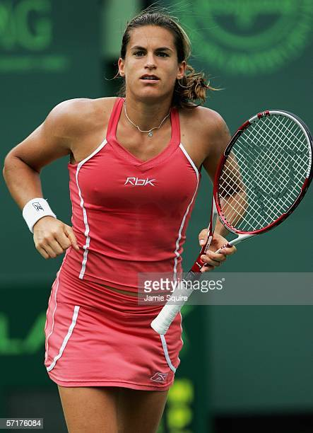 Amelie Mauresmo of France celebrates defeating Samantha Stosur of Australia in straight sets in the women's second round of the Nasdaq100 Open part...
