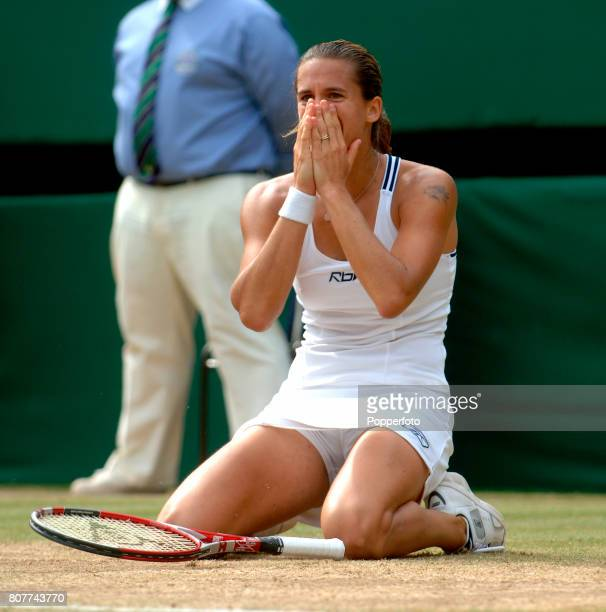 Amelie Mauresmo of France celebrates match point over Justine Henin-Hardenne of Belgium during the women's final match on day twelve of the Wimbledon...