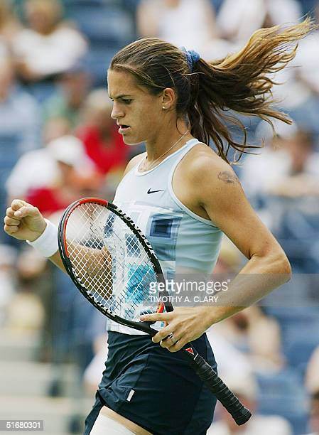 Amelie Mauresmo of France celebrates scoring a point against Jennifer Capriati of the US during their quarter final match at the US Open Tennis...