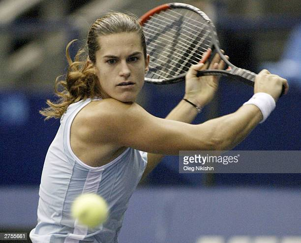 Amelie Mauresmo of France hits a forehand return to Meghann Shaughnessy of USA during the 41st Fed Cup Final at Olympic Stadium at at Olympic Stadium...
