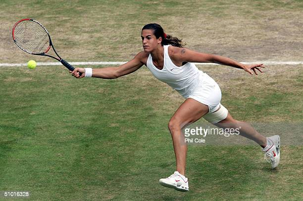 Amelie Mauresmo of France in action during her semi final match against Serena Williams of USA at the Wimbledon Lawn Tennis Championship on July 1...