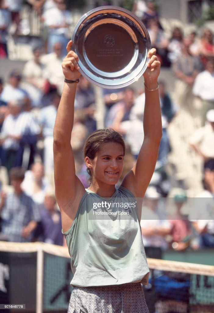Amelie Mauresmo of France lifts the trophy after defeating Meghann Shaughnessy of the USA (not in picture) in the Girls' Singles Final of the French Open Tennis Championships at the Stade Roland Garros on July 7, 1996 in Paris, France.