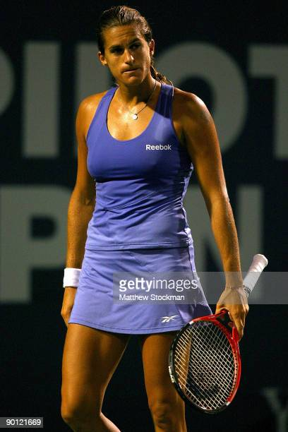 Amelie Mauresmo of France reacts to a lost point against Svetlana Kuznetsova of Russia during the Pilot Pen Tennis tournament at the Connecticut...
