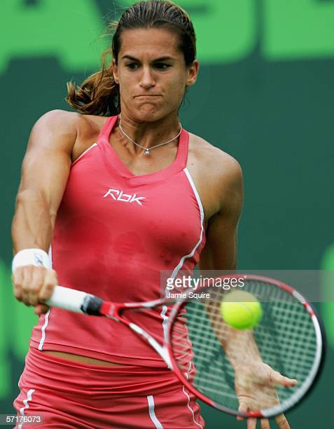 Amelie Mauresmo of France returns a backhand to Samantha Stosur of Australia in the women's second round of the Nasdaq100 Open part of the Sony...