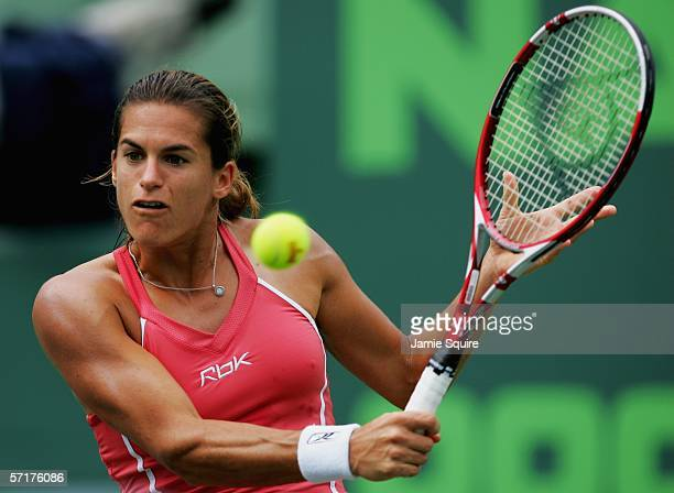 Amelie Mauresmo of France returns a backhand to Samantha Stosur of Australia in the women's second round of the Nasdaq-100 Open, part of the Sony...