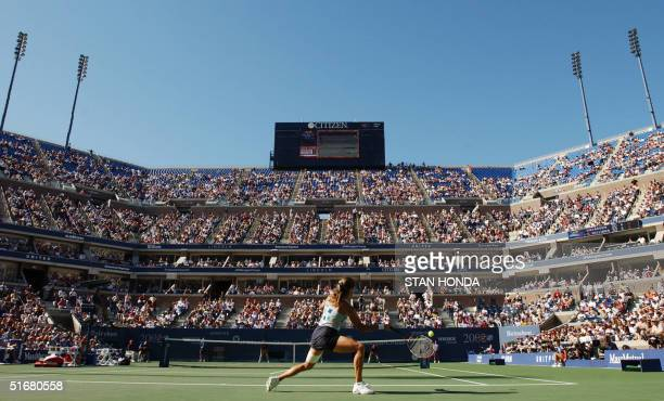 Amelie Mauresmo of France returns a backhand to Venus Williams of the US on center court during their semi final match at the US Open Tennis...