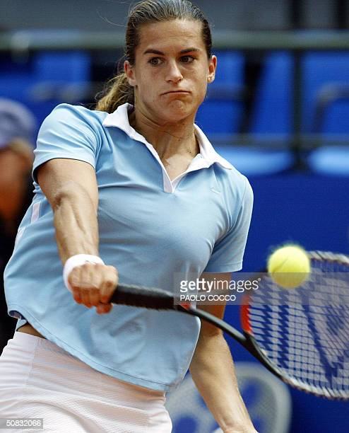 Amelie Mauresmo of France returns a ball to Spain's Conchita Martinez during their match at the Italian Masters in Rome 13 May 2004 Mauresmo won the...