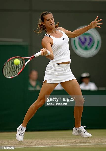 Amelie Mauresmo of France returns a forehand to Anastasia Myskina of Russia during day eight of the Wimbledon Lawn Tennis Championships at the All...