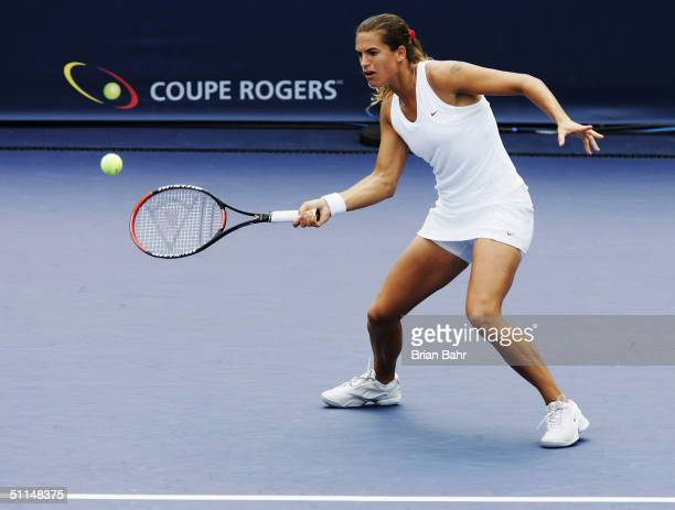 Amelie Mauresmo of France returns a shot against Karolina Sprem of Croatia during the quarterfinals of the Rogers Cup tennis, on August 6, 2004 at...