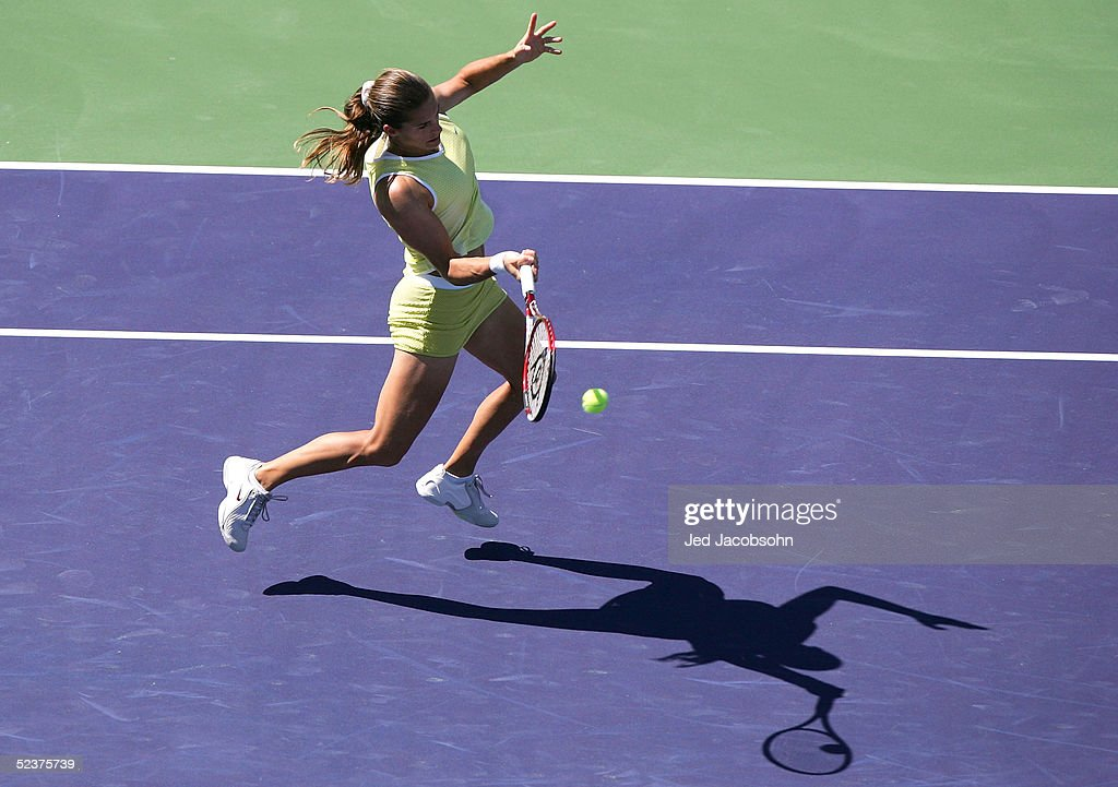 Amelie Mauresmo of France returns a shot against Tathiana Garbin of Italy during the Pacific Life Open at the Indian Wells Tennis Garden on March 11, 2005 in Indian Wells, California.