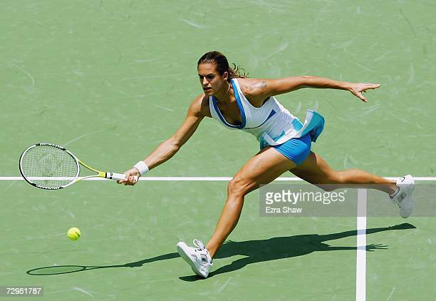 Amelie Mauresmo of France returns a shot to Tatiana Golovin of France during their match on day three of the 2007 Medibank International at the...