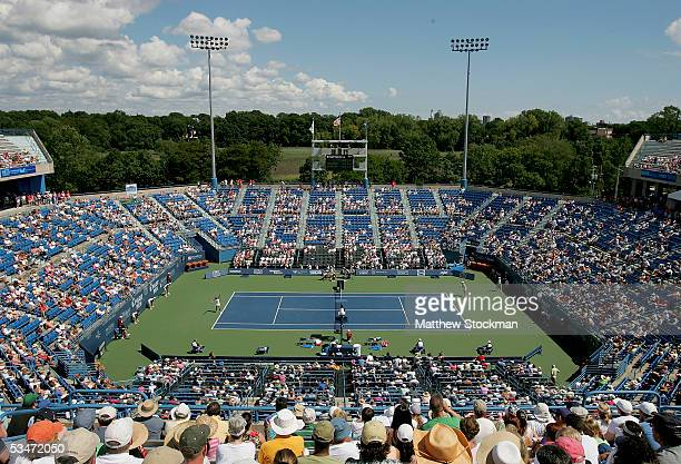 Amelie Mauresmo of France serves to Lindsay Davenport during the final of the Pilot Pen Tennis tournament on August 27, 2005 at the Connecticut...