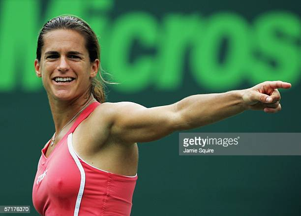 Amelie Mauresmo of France signals during her match against Samantha Stosur of Australia in the women's second round of the Nasdaq100 Open part of the...
