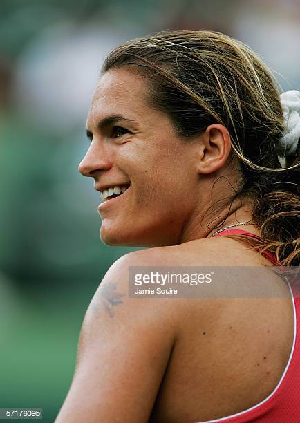 Amelie Mauresmo of France smiles after defeating Samantha Stosur of Australia in the women's second round of the Nasdaq100 Open part of the Sony...