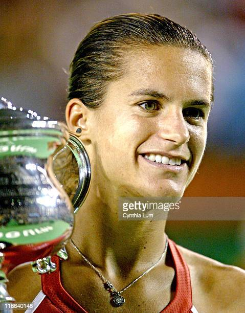 Amelie Mauresmo poses with the trophy after beating Justine HeninHardenne in the women's singles final at the 2006 Australian Open at Melbourne Park...