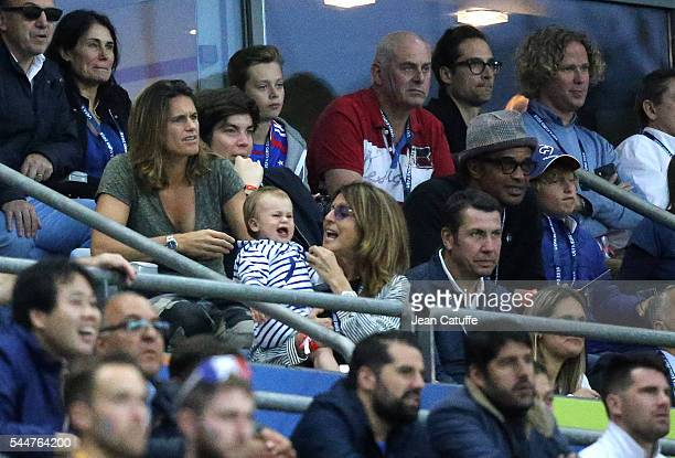 Amelie Mauresmo Yannick Noah and his son Joalukas Noah attend the UEFA Euro 2016 quarter final match between France and Iceland at Stade de France on...