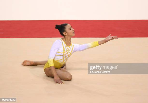 Amelie Morgan of The Academy performs oher floor routine during The Women's Junior AllAround Subdivision 2Round during the Gymnastics British...
