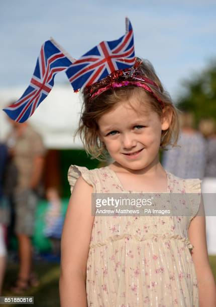 Amelie Tayton aged three from Upper Bucklebury poses with a pair of Union Flags on her head in the car park of the Cottage Inn in Upper Bucklebury...