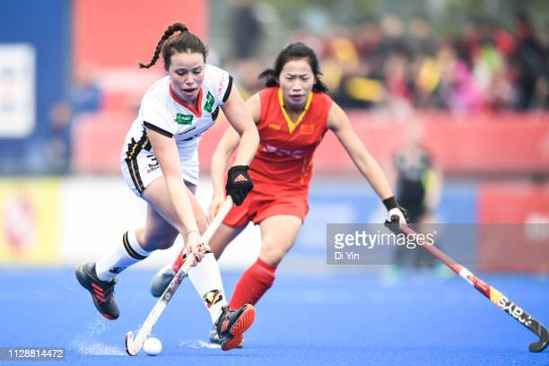 Amelie Wortmann of Germany battles for the ball with Xu Wenyu of China during the Women's FIH Field Hockey Pro League match between China and Germany...