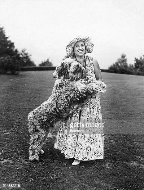 Amelita GalliCurci Italian born operatic soprano during one of her informal moments playing with her dog Undated photograph