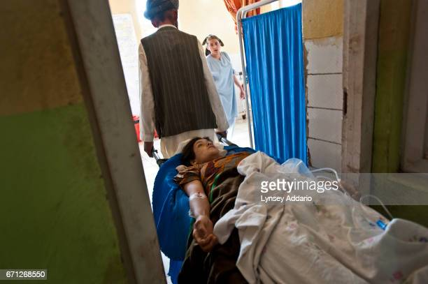 Amena an Afghan woman from the village of Argo suffered septic shock after giving birth to a stillborn child at home in Faizabad Badakshan...
